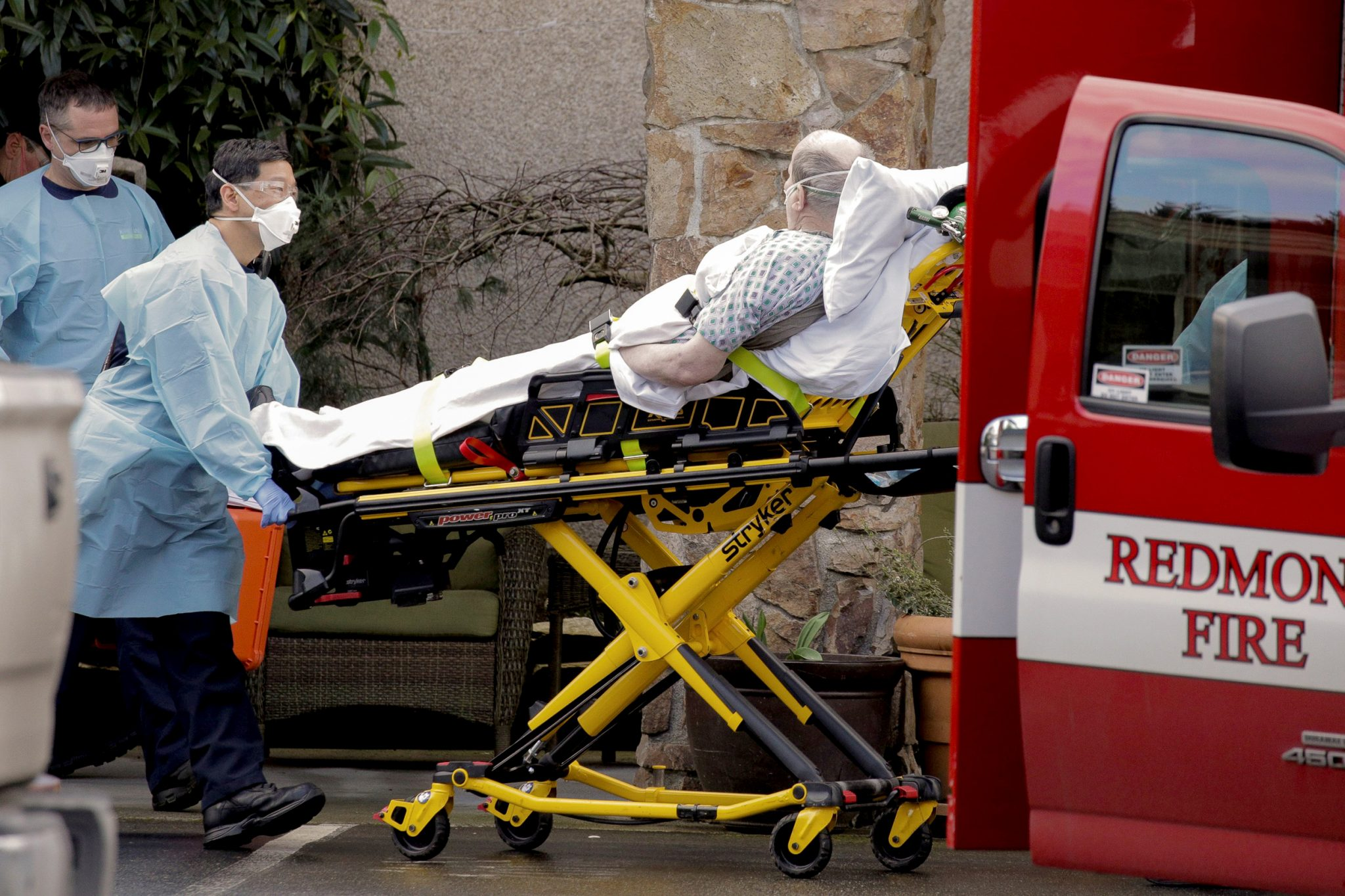 Image: Medics transport a man on a stretcher into an ambulance at the Life Care Center, a long-term care facility linked to several confirmed coronavirus cases, in Kirkland